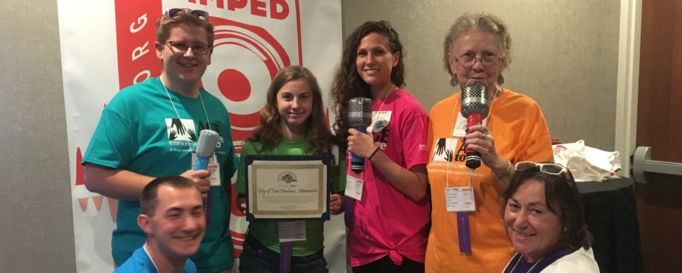 Two Harbors Community Radio and Age2age accept Intergenerational City Award in Milwaukee